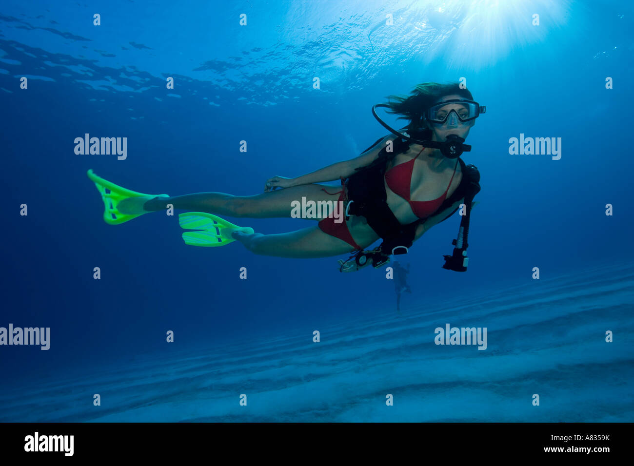 Woman diver with SCUBAPRO Twin Jet fins Paradise Reef divesite Cozumel Mexico - Stock Image