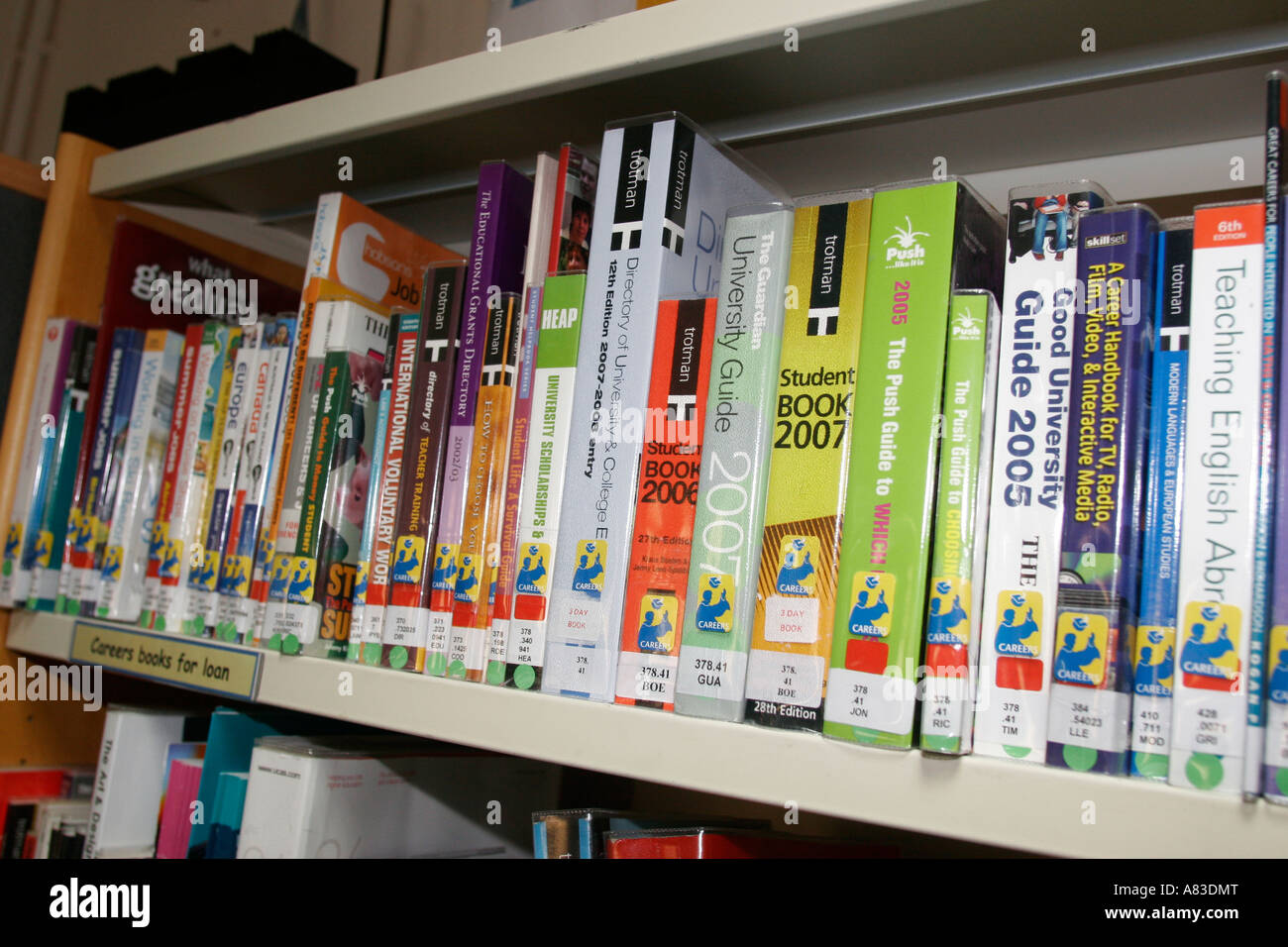 Careers books and literature on shelves in college library at sixth 6th Form College - Stock Image