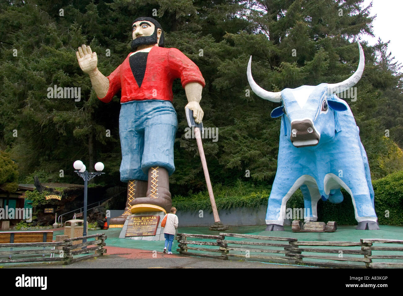 Giant statues of Paul Bunyan and Babe the Blue Ox guard the entrance to the Trees of Mystery at Klamath California - Stock Image