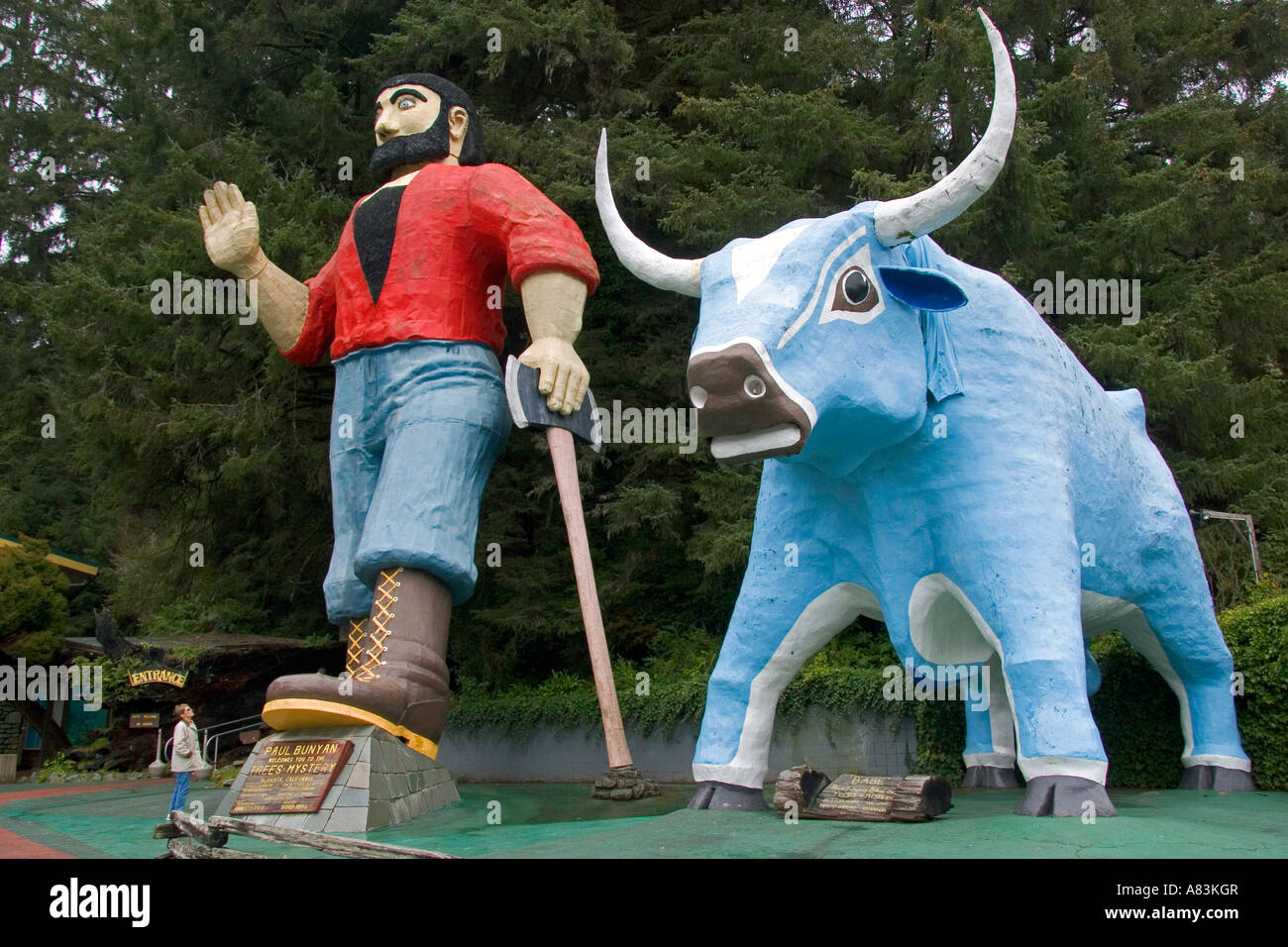Giant statues of Paul Bunyan and Babe the Blue Ox guard the entrance of the Trees of Mystery at Klamath California - Stock Image