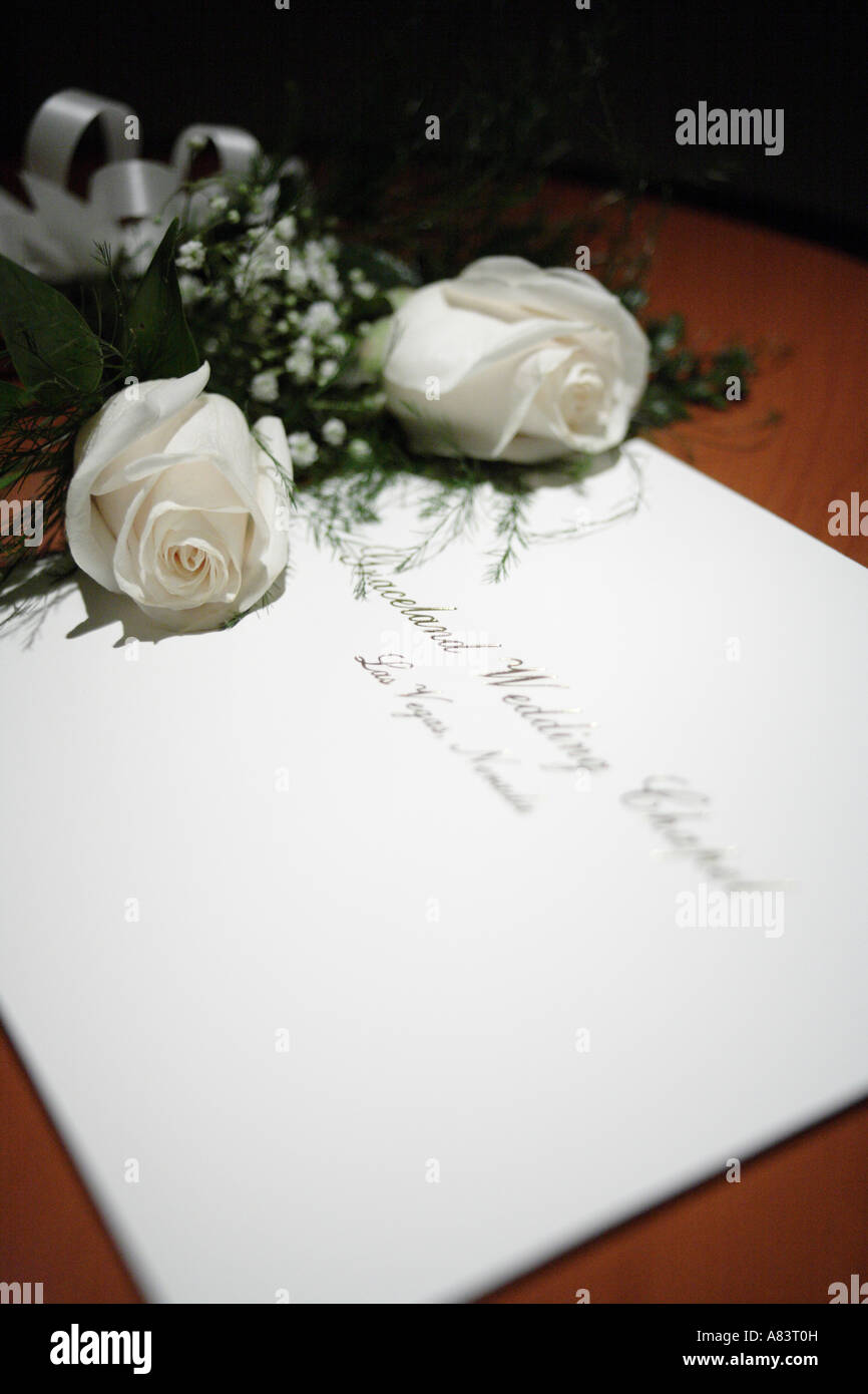 Close Up Of Marriage Certificate With Two White Roses Las Vegas
