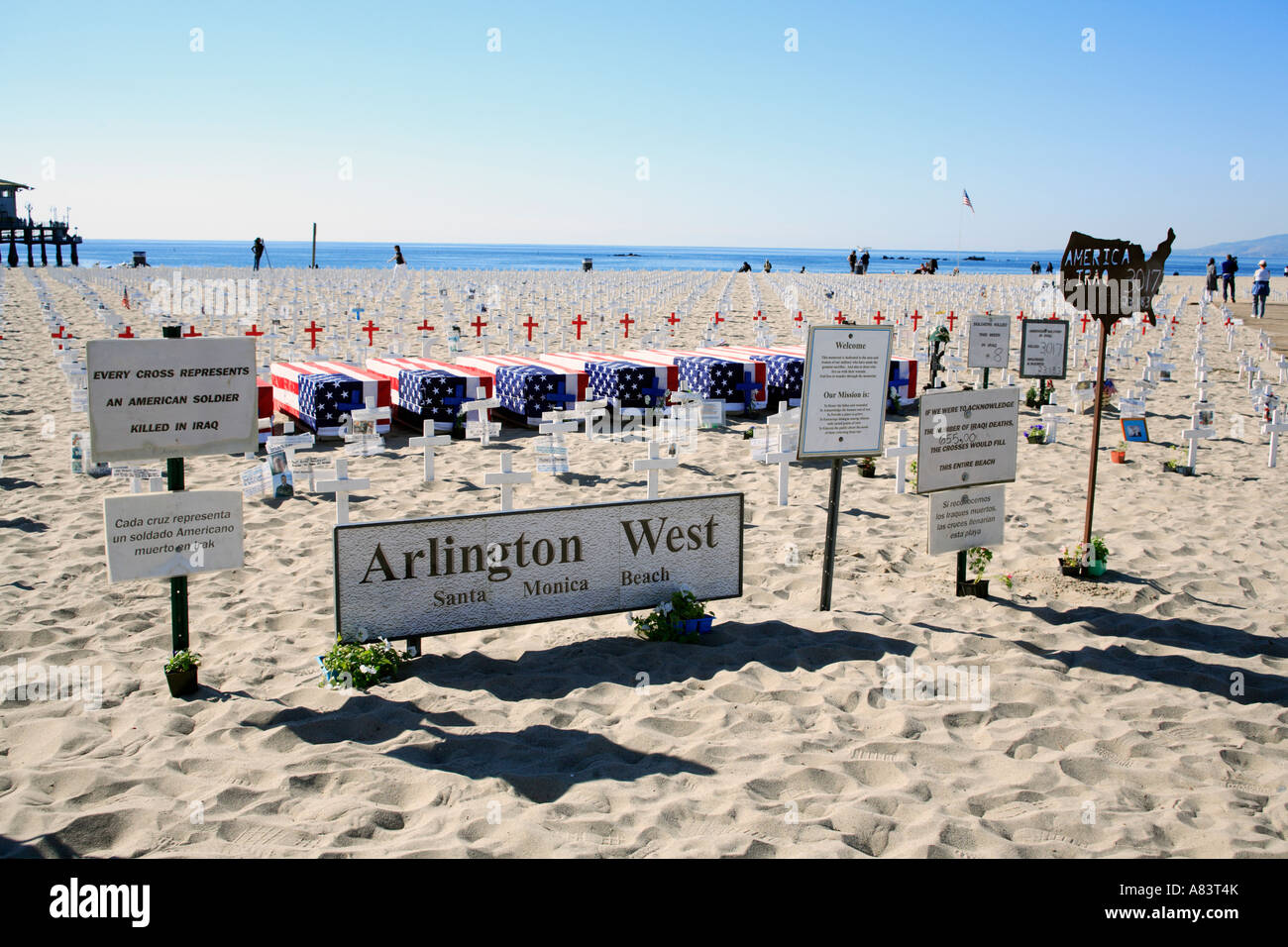 symbolic demonstration with grave crosses and coffins against iraq war at beach. santa monica, california, usa - Stock Image