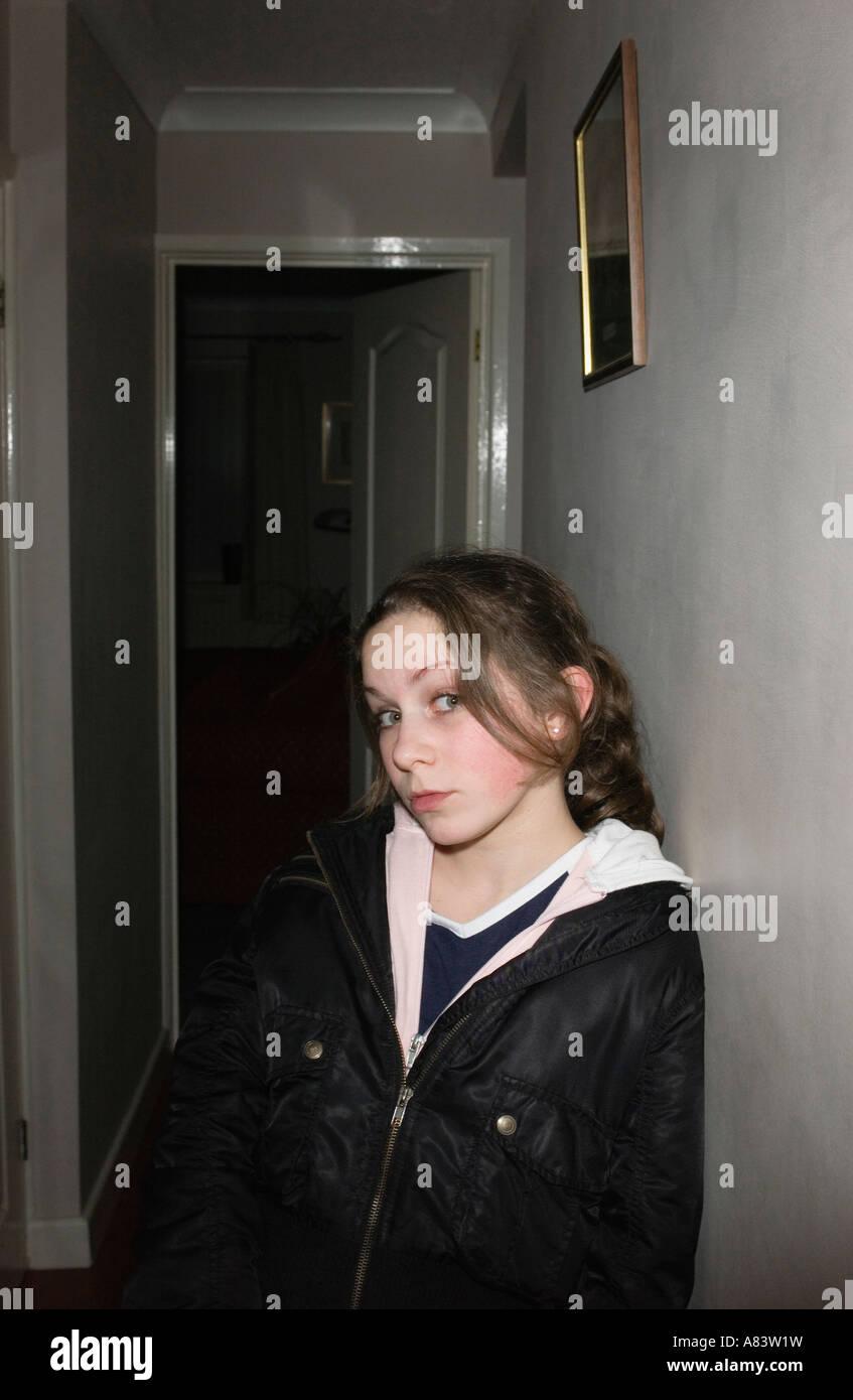 Portrait of girl standing in hallway - Stock Image