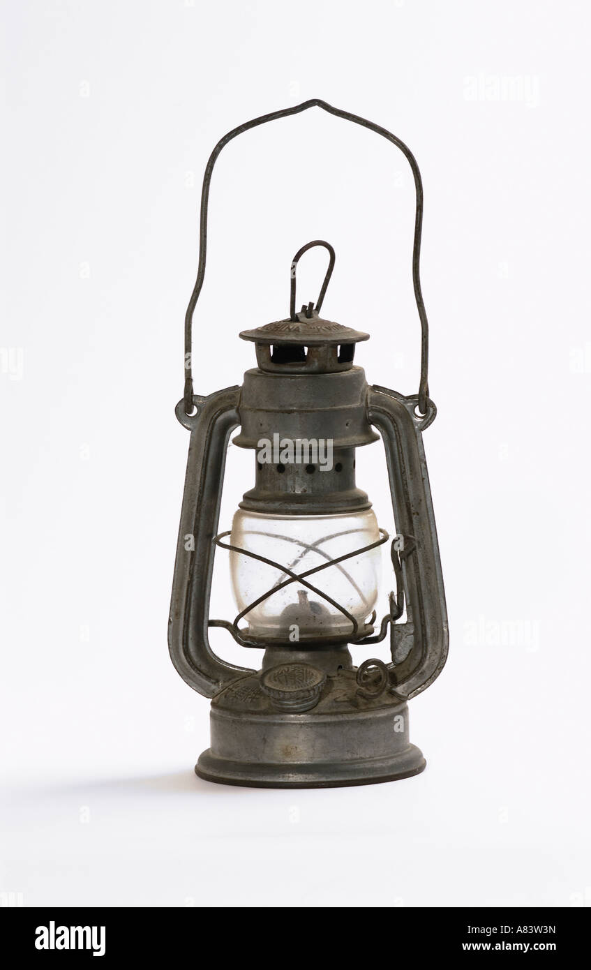Paraffin hurricane lamp on white background - Stock Image