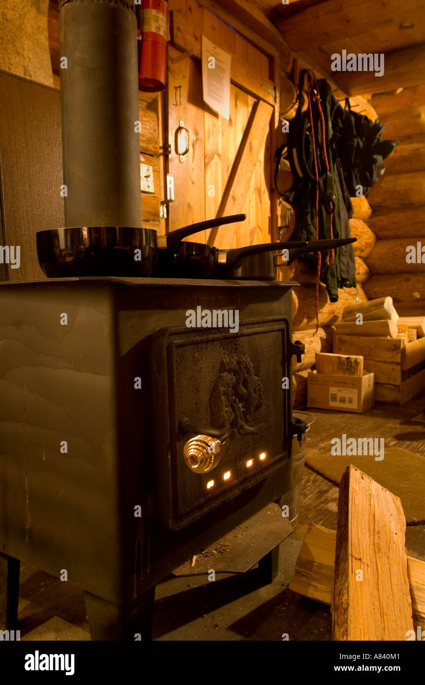 Cooking on the wood burning stove Snowshoe cabin Snowshoe Country Lodge Isabella Minnesota - Stock Image