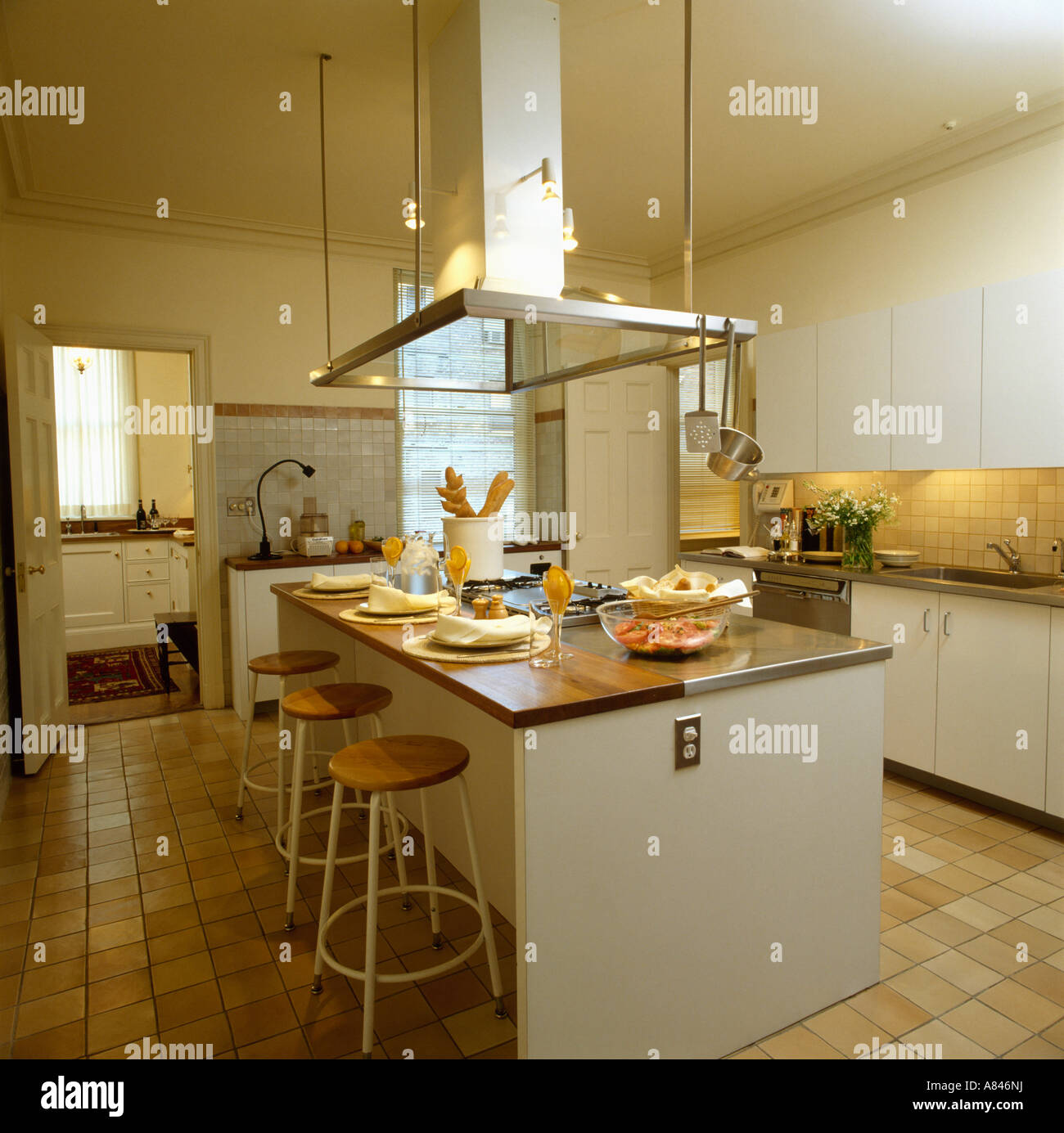 Large Extractor Fan Over Island Unit In Modern White Kitchen With Stock Photo Alamy