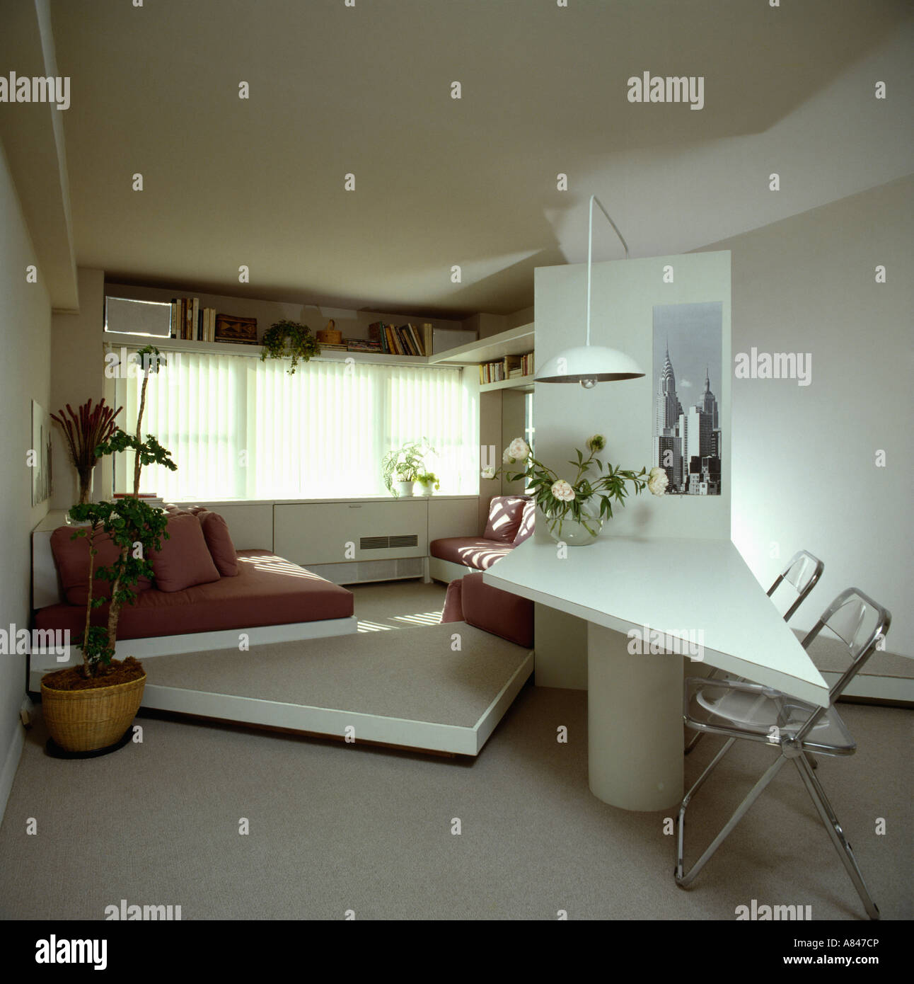 White Triangular Table And Raised Floor In Eighties Study Bedroom With Grey  Carpet   Stock Image