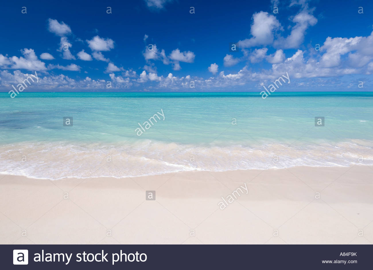 A classic view of turquoise seas and white sand beach, at Dickenson Bay, Antigua, Leeward Islands, Caribbean - Stock Image