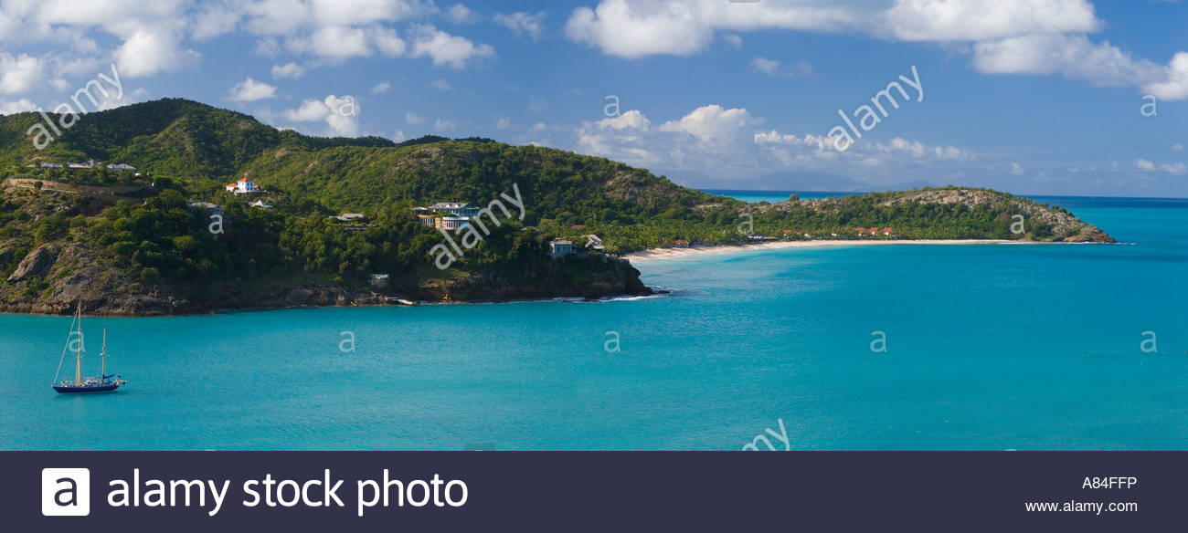 Panoramic view of Galley Bay beach with yacht moored offshore, Antigua, Leeward Islands, Caribbean - Stock Image
