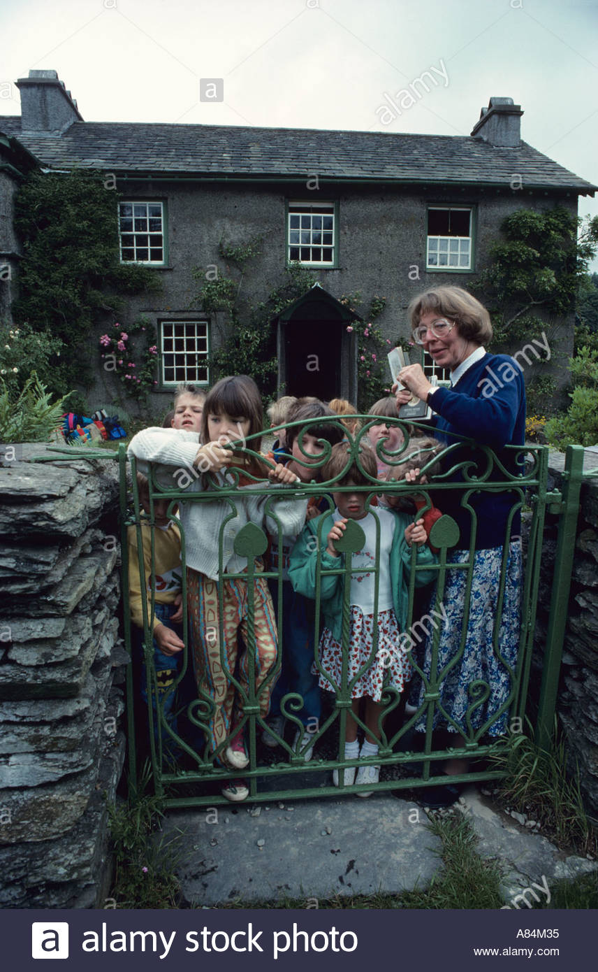 Schoolchildren visiting the home and garden of the writer Beatrix Potter in the village of Near Sawby - Stock Image