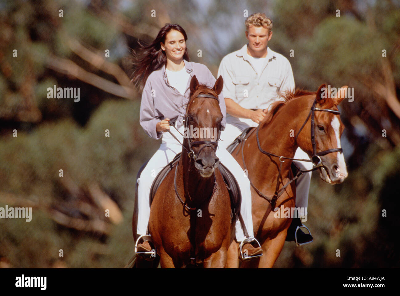 Young Couple Horse Riding Outdoor Lifestyle Stock Photo Alamy