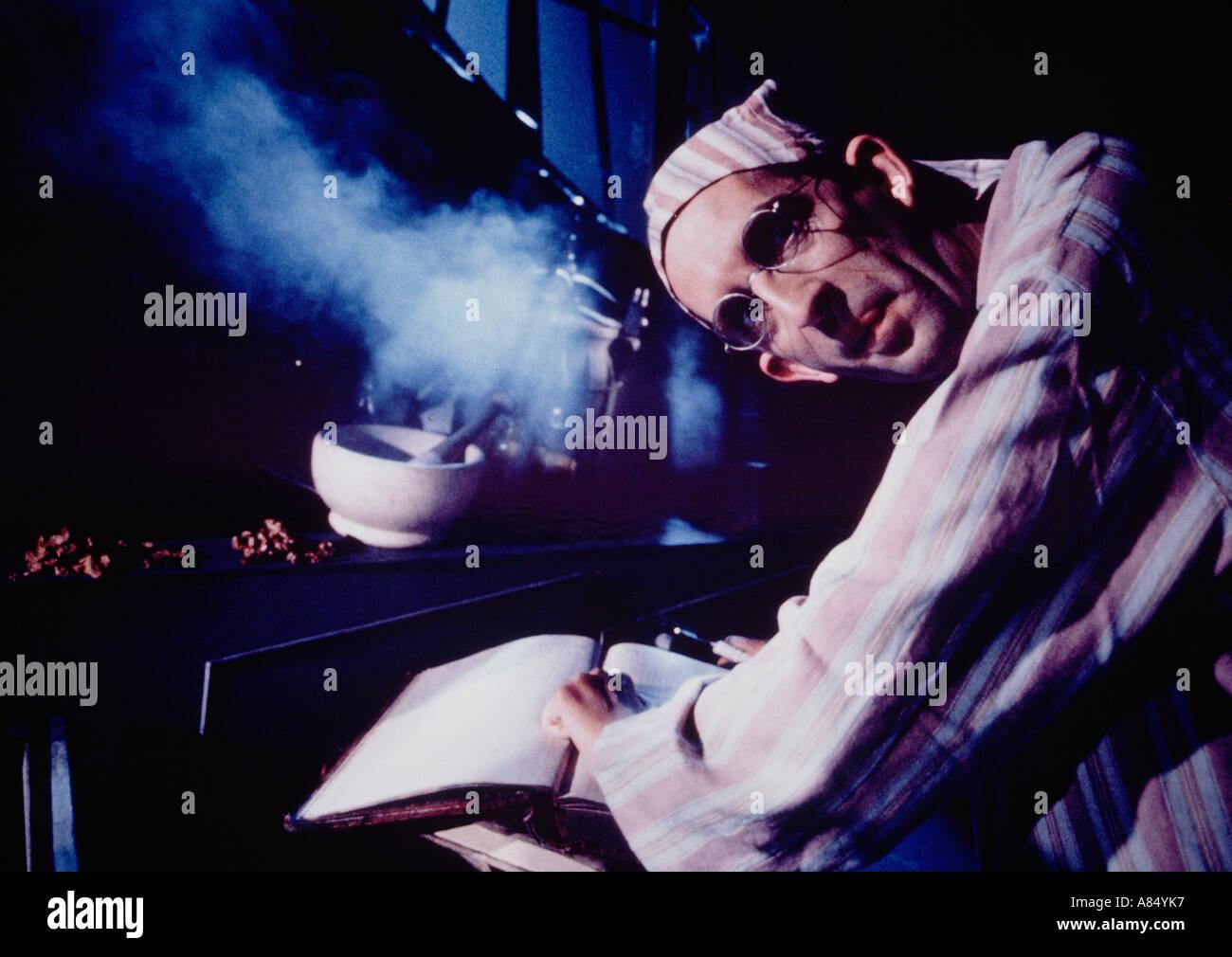Concept. Alchemist. Close up of man indoors. - Stock Image