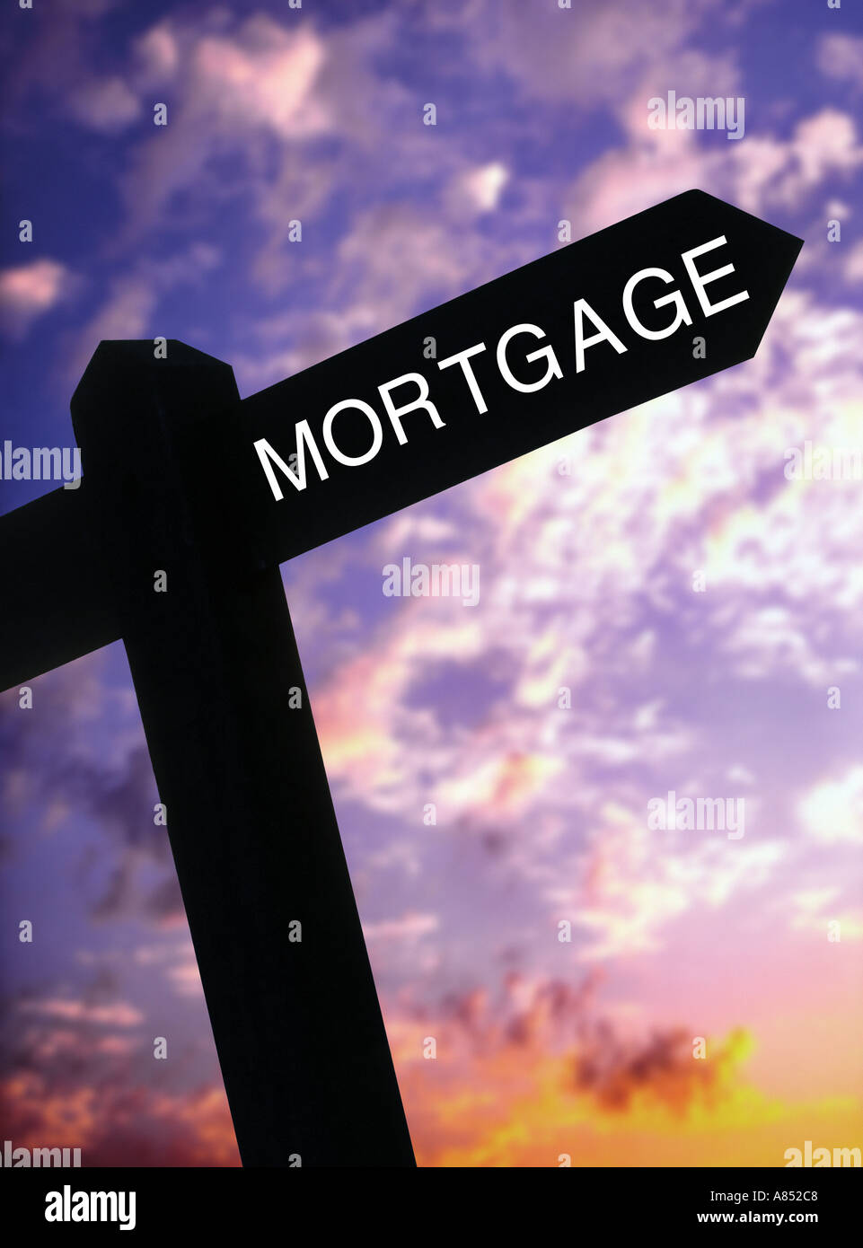 signpost pointing to a mortgage - Stock Image