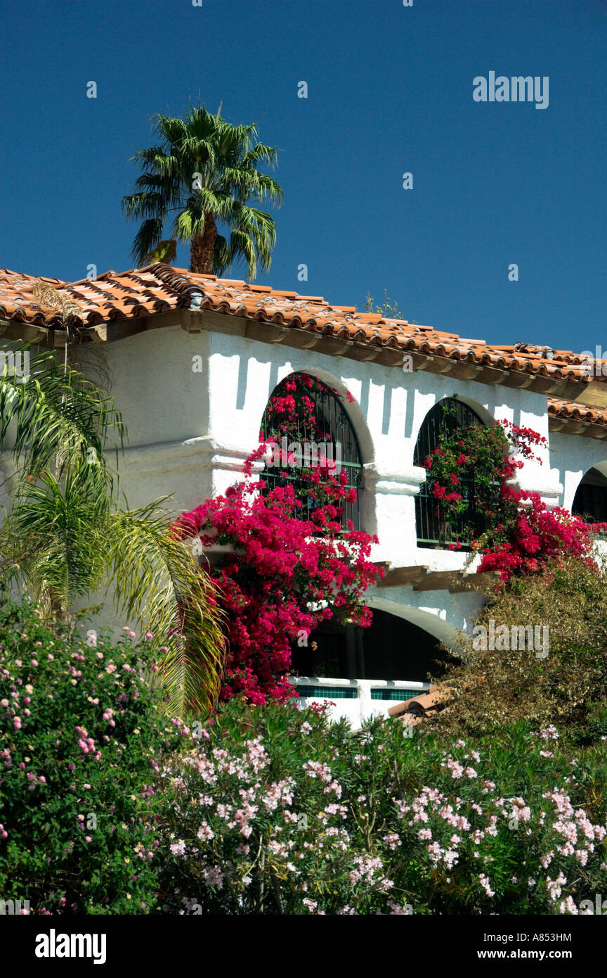 Tropical vegetation adorns the Spanish architecture at the Las Brisas Best Western Resort in Palm Springs California - Stock Image