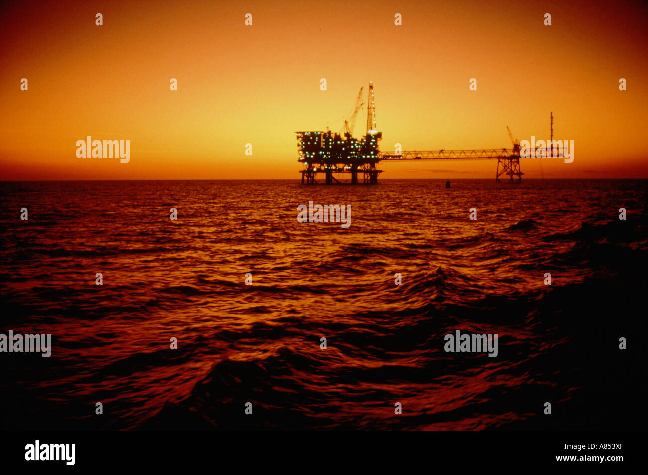 North Rankin A offshore oil rig in ocean sunset. Australia. - Stock Image