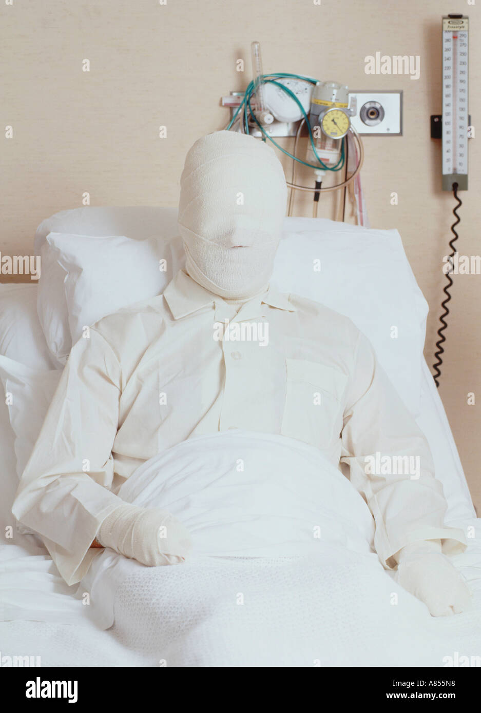 Male patient with serious burns bandaging lying in hospital bed Stock Photo  - Alamy