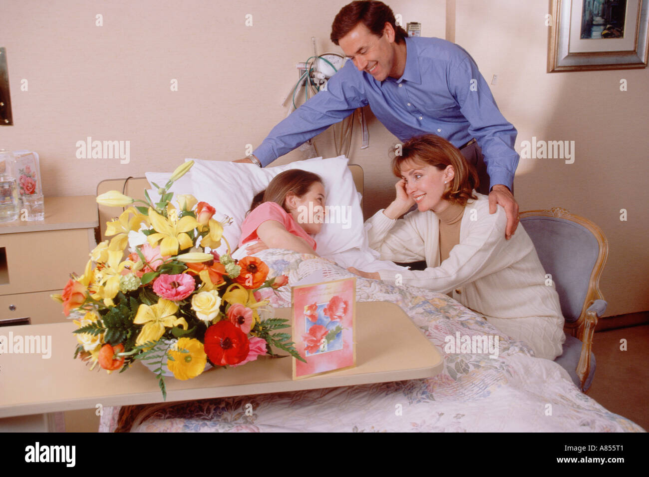 Family visiting their girl child in hospital. - Stock Image