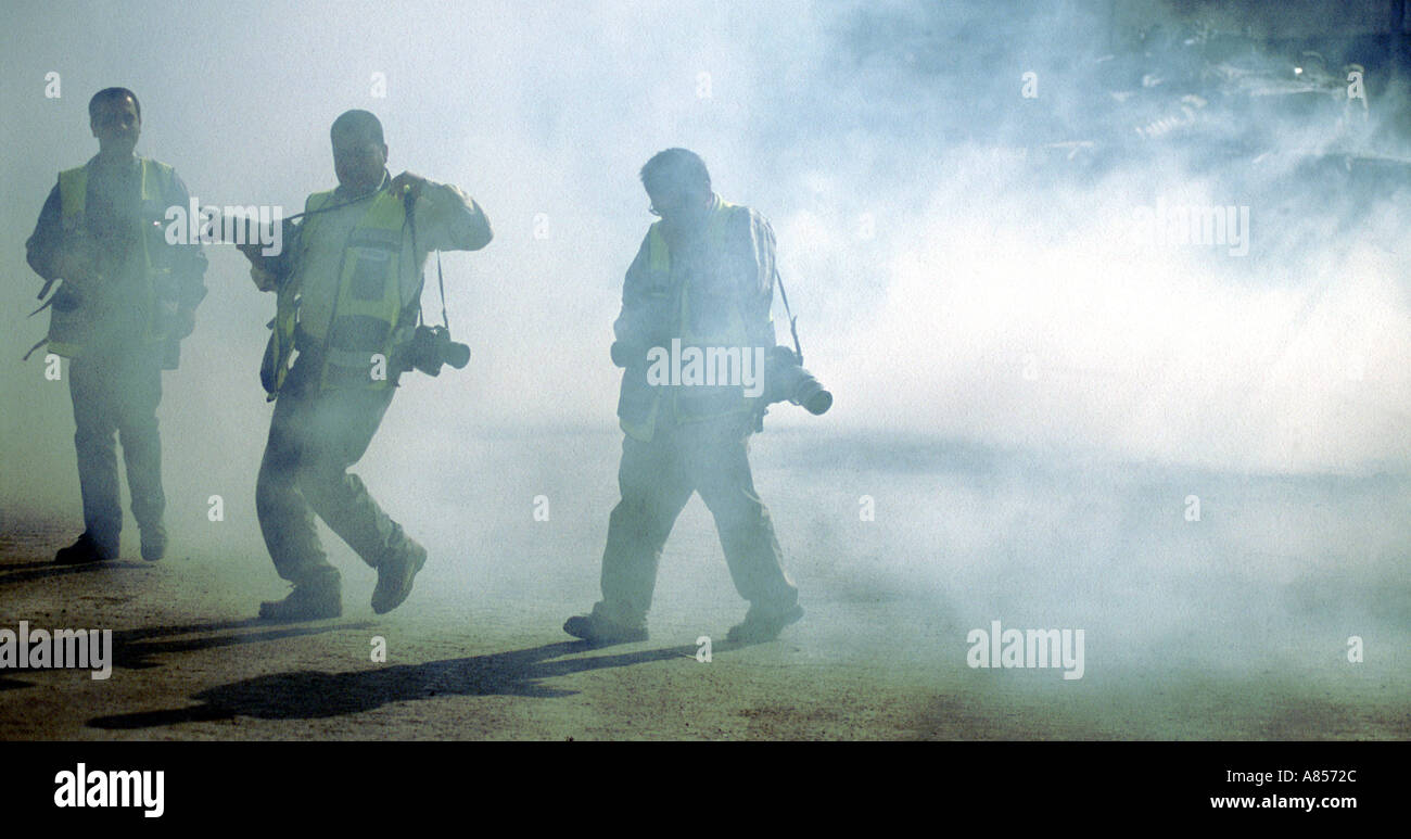 The press under attack from Israeli soldiers with tear gas Nablus November 2002  - Stock Image