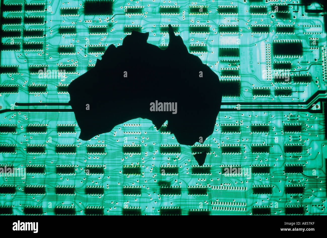 Still life montage concept of Australia continent map silhouetted against computer circuit board. - Stock Image