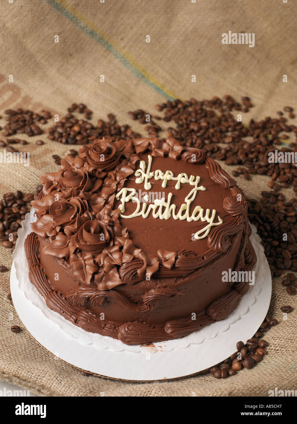 Astounding Chocolate Birthday Cake On Burlap Surrounded By Coffee Beans Stock Funny Birthday Cards Online Elaedamsfinfo