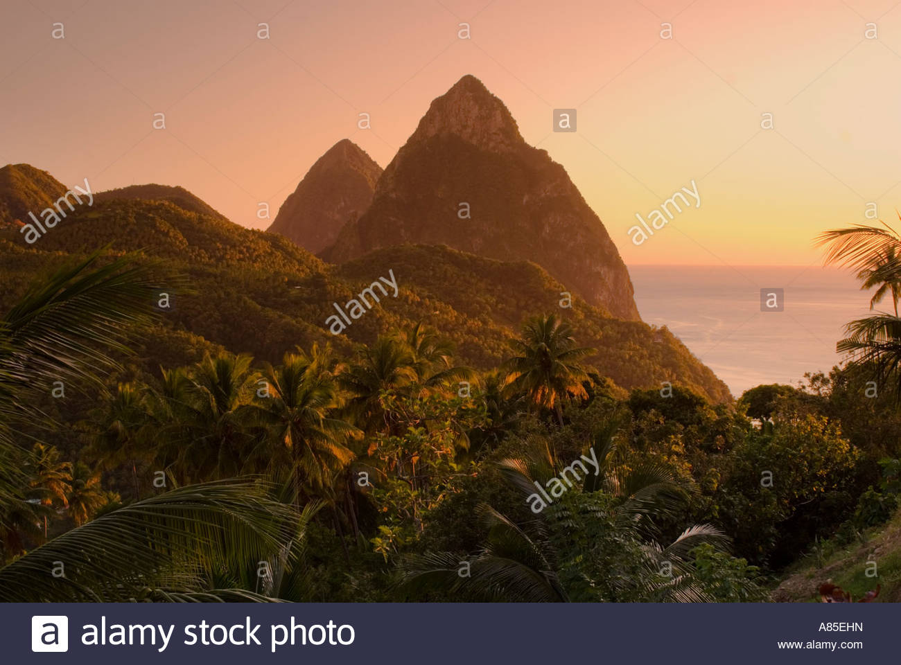 The Pitons, near Soufriere, at sunset; St Lucia, Windward Islands, Caribbean. - Stock Image