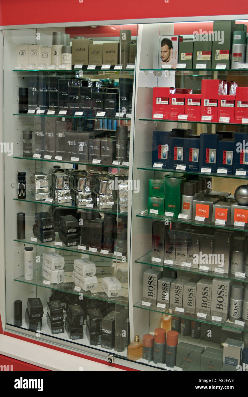Glass Cabinet Displaying Mens Perfume And Aftershave In A High Street  Cosmetics Shop