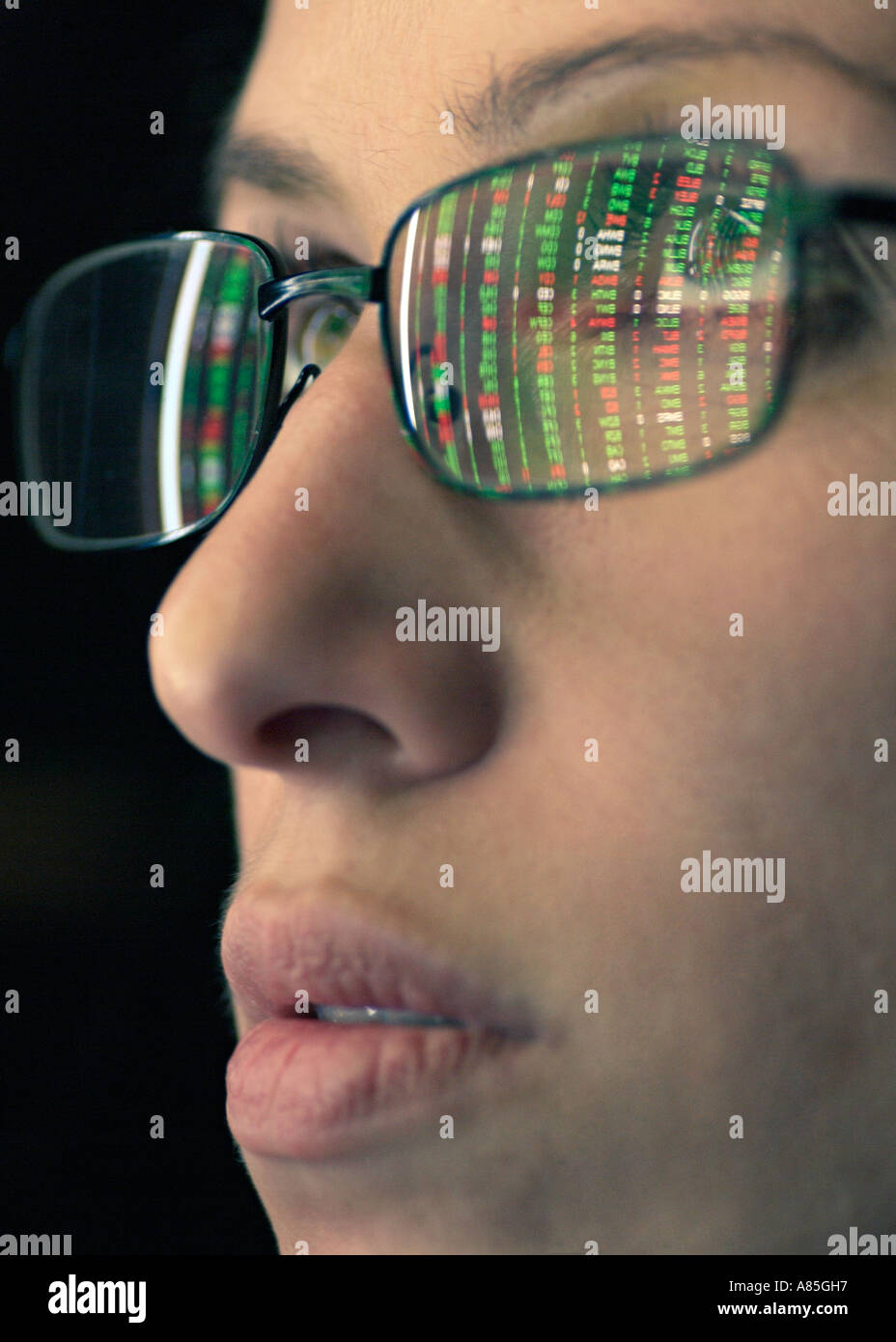 Stock Broker with Stock Market Prices Reflected on Spectacles, Close Up. - Stock Image