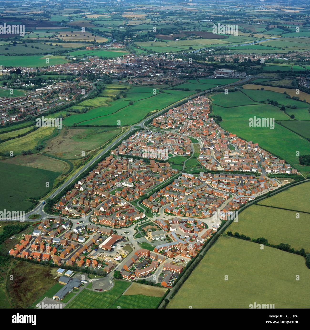 Modern edge of town housing estate UK aerial view - Stock Image