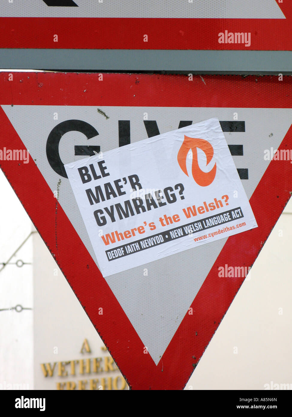 Where's the Welsh poster protest by Welsh Language Society on Give Way road traffic sign in Merthyr Tydfil South - Stock Image