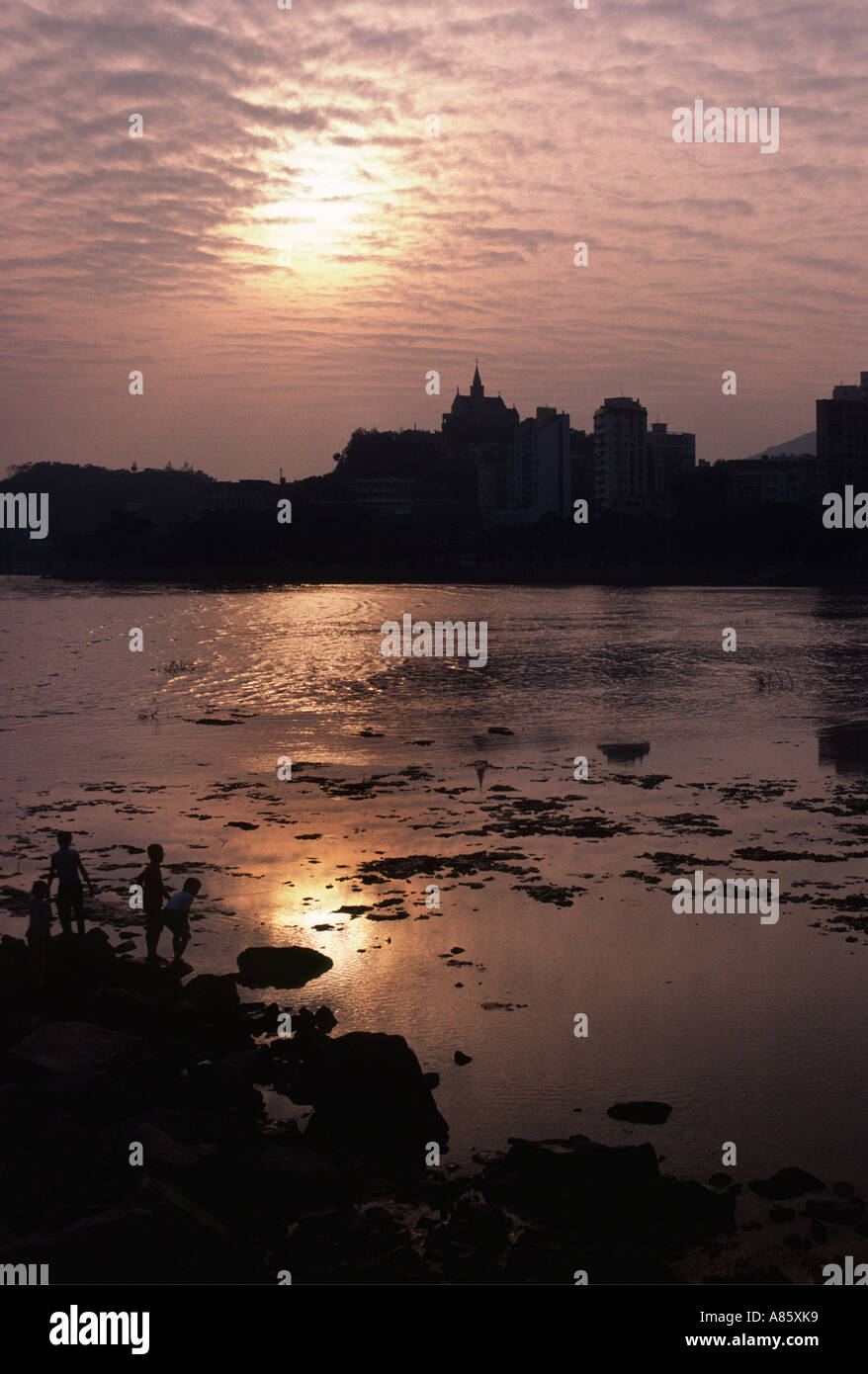 Family group- Macau sunset - Stock Image