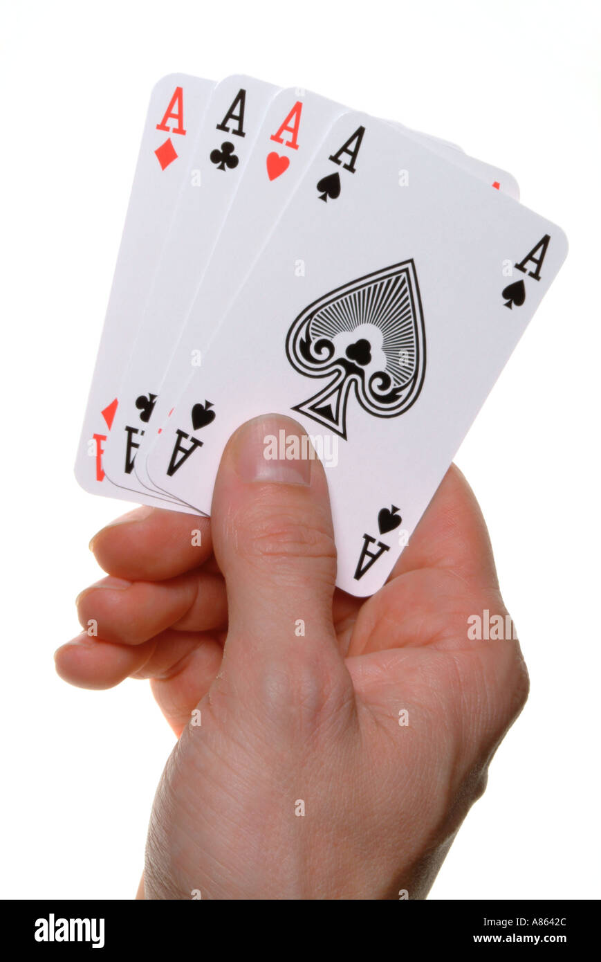 mans hand holding four ace playing cards - Stock Image
