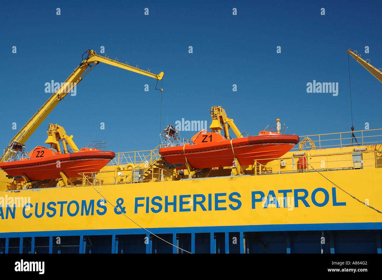 Customs and Fisheries Patrol boats which enforce immigration and fisheries regulations throughout Australian territorial waters - Stock Image