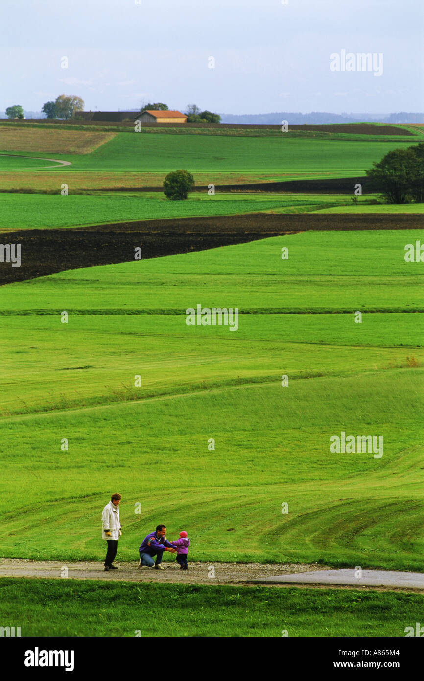 Family walking through Upper Bavaria countryside in Germany - Stock Image