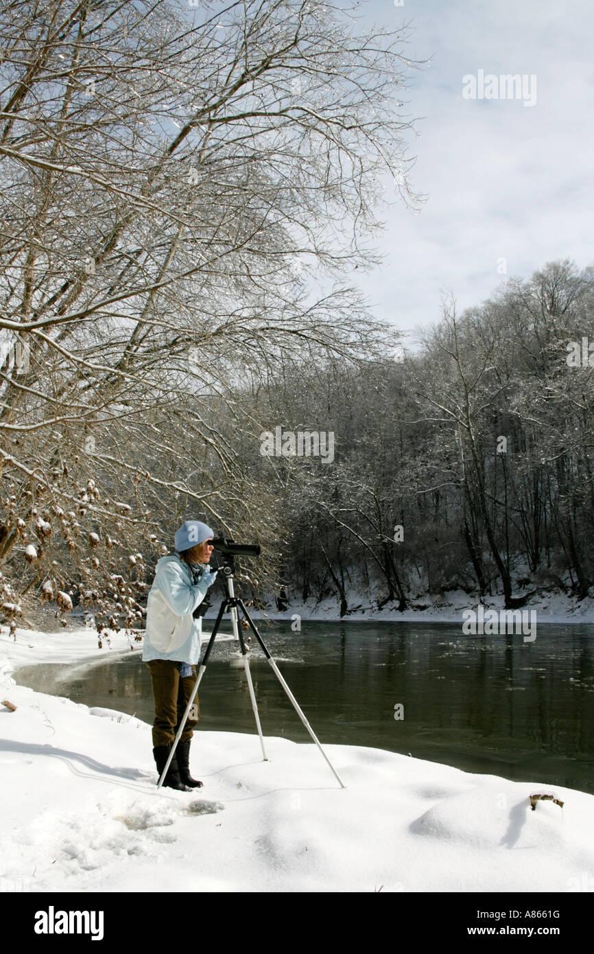 Winter Birdwatcher using Spotting Scope - Vertical - Stock Image