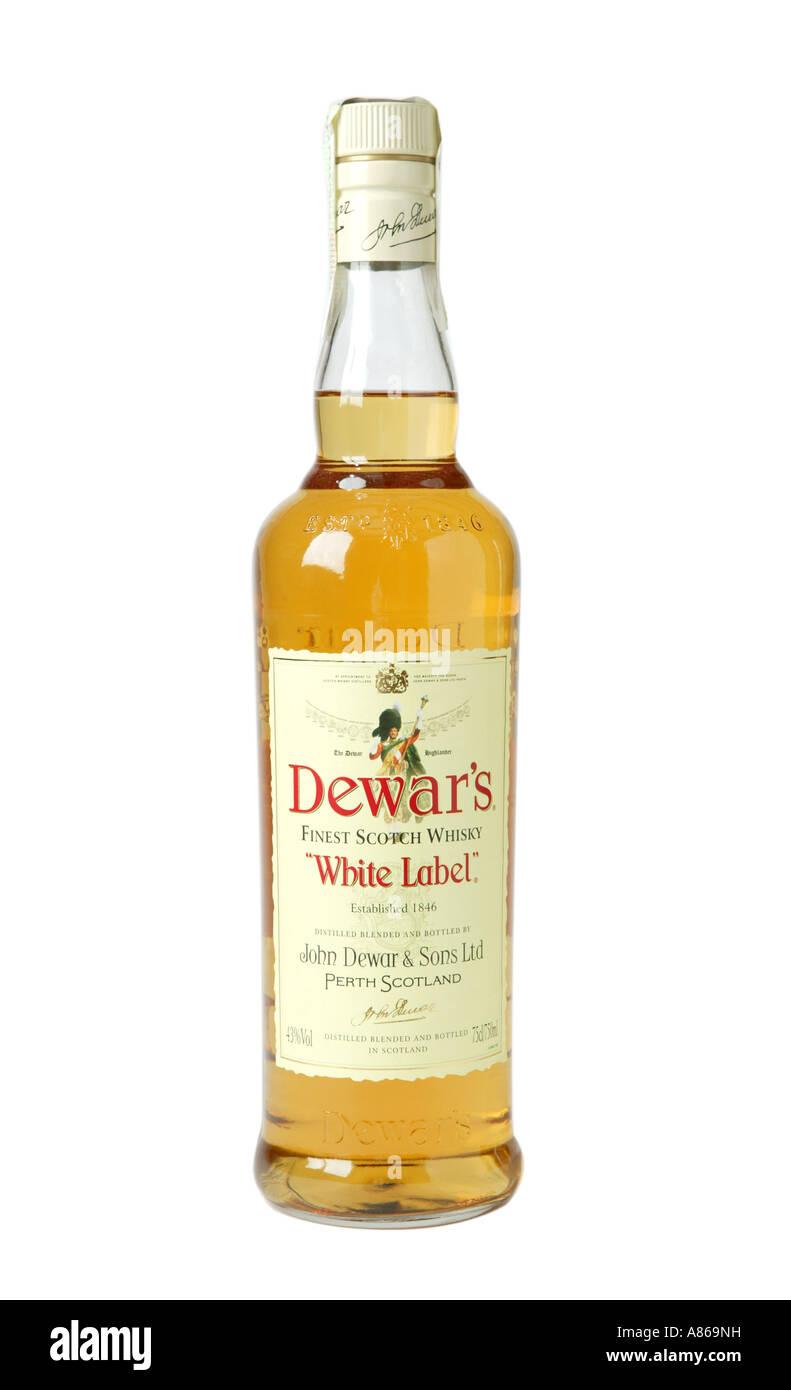 Dewars white label whiskey on studio white background showing yellow color of whiskey - Stock Image
