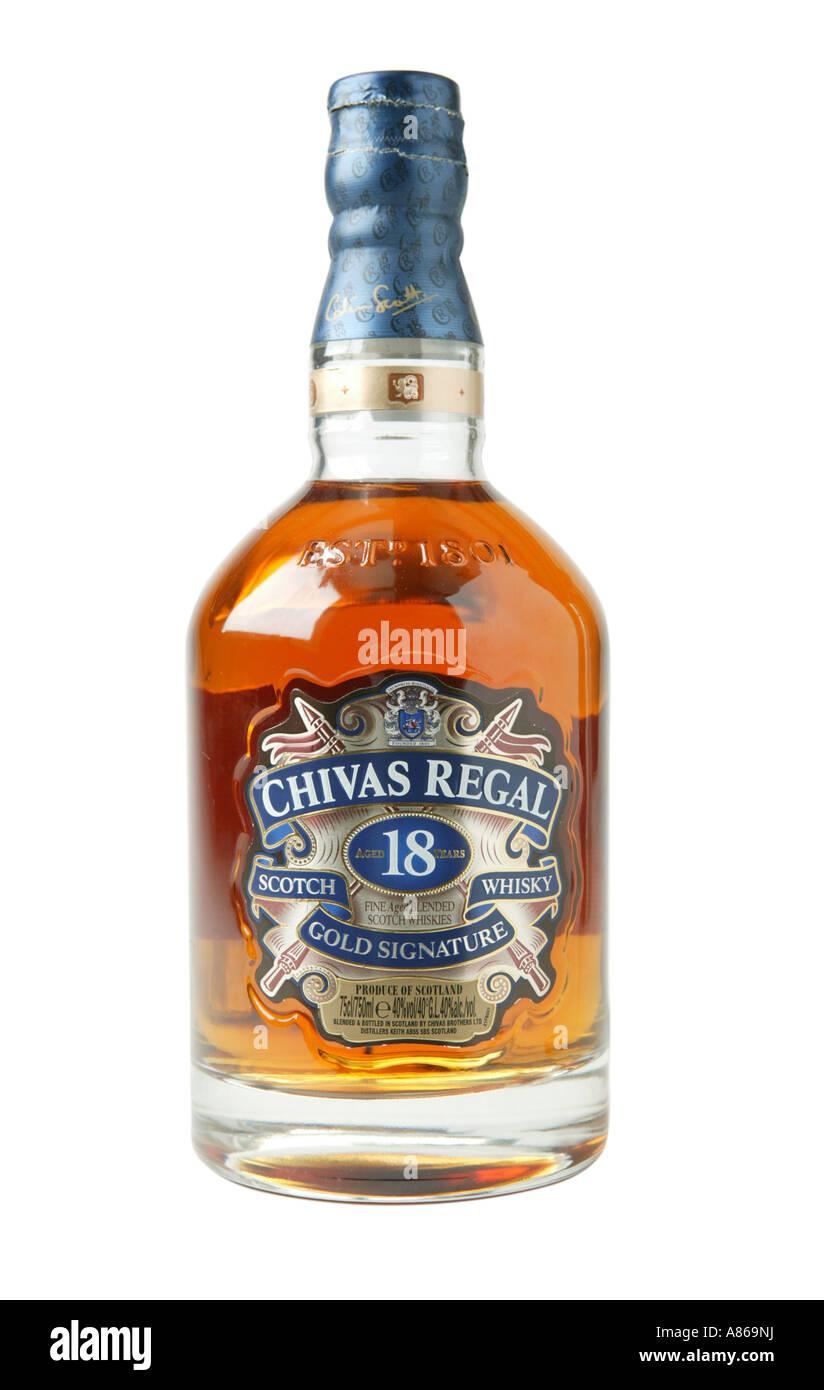 Chivas Regal 18 year old whiskey on studio white background shpwing yellow whiskey colr through glass - Stock Image