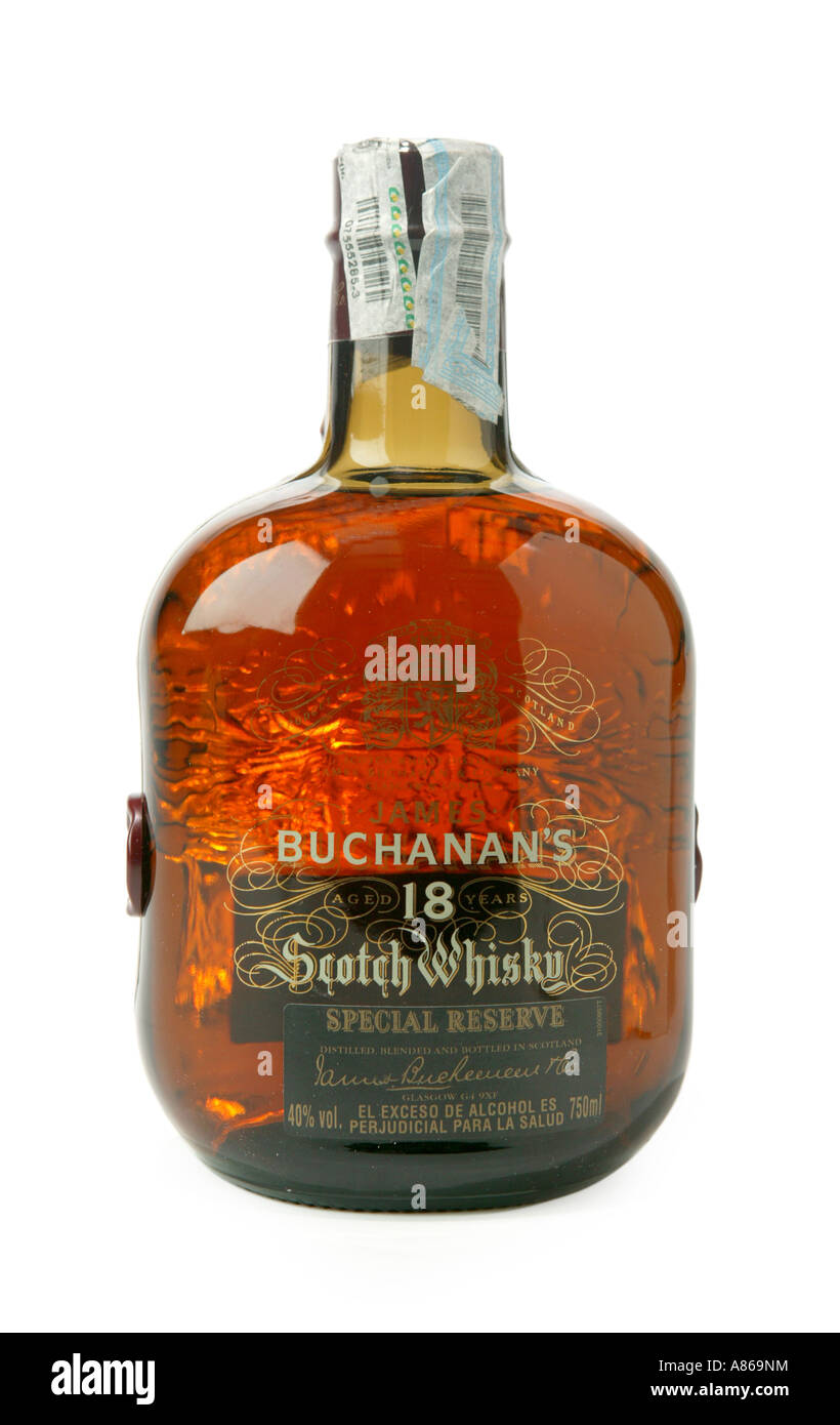 Buchana s 18 year old whiskey on studio white background shpwing yellow whiskey colr through glass - Stock Image