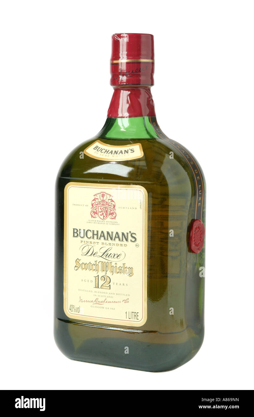 Buchanan s 12 year old whiskey on studio white background showing yellow whiskey color through glass - Stock Image