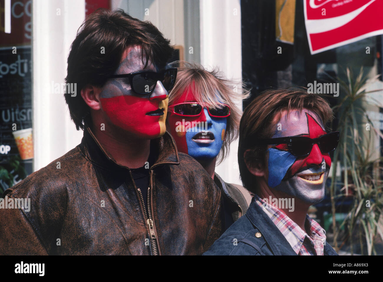 Soccer fans in Amsterdam with painted faces on game day - Stock Image