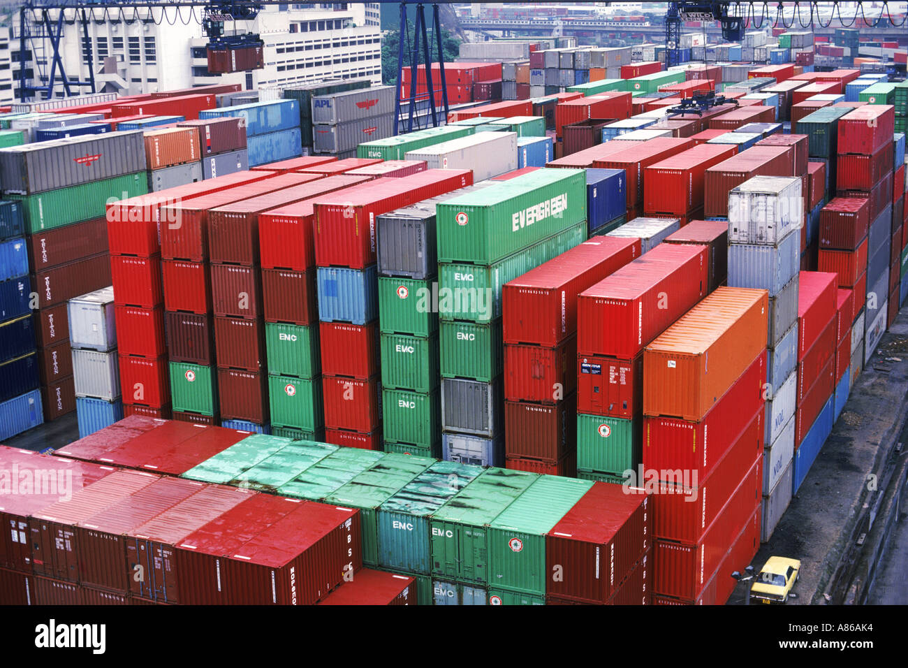 Cargo containers stacked in Singapore Harbor - Stock Image