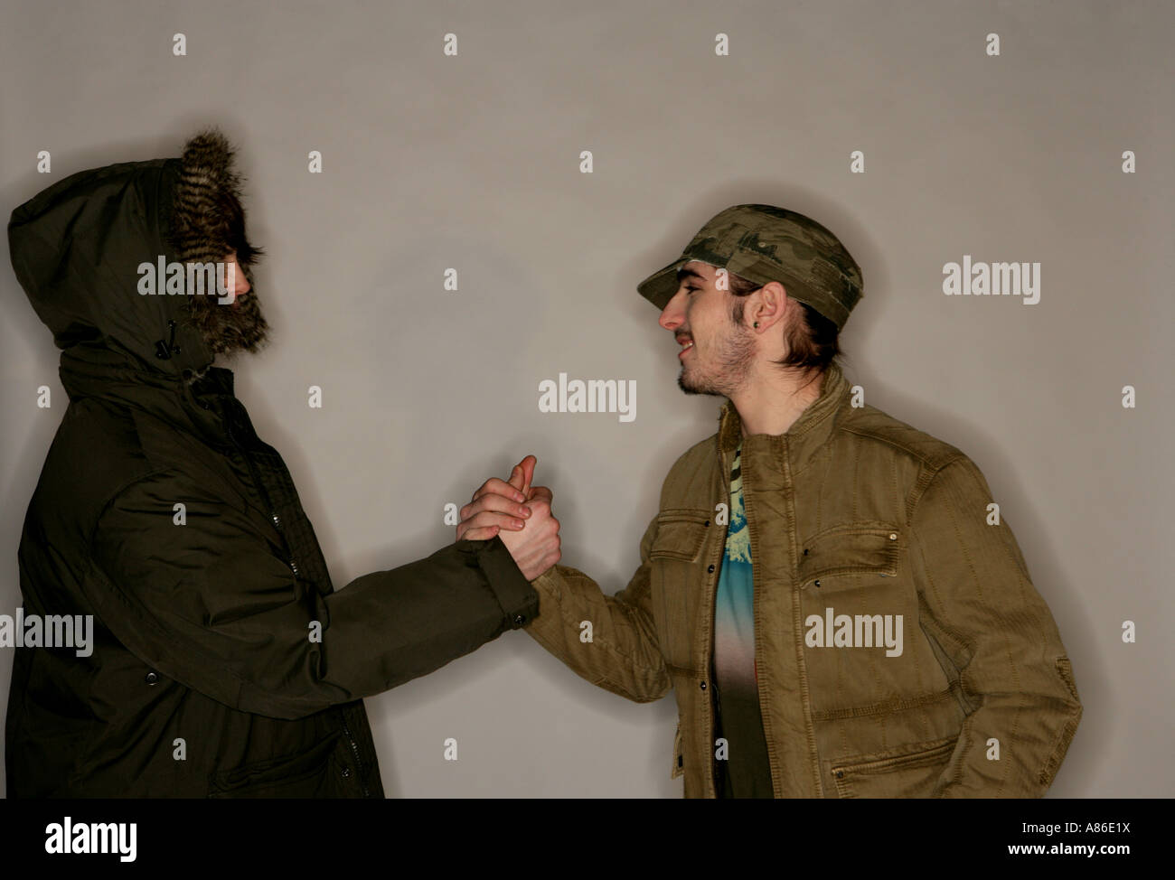 Two young men greeting each other - Stock Image