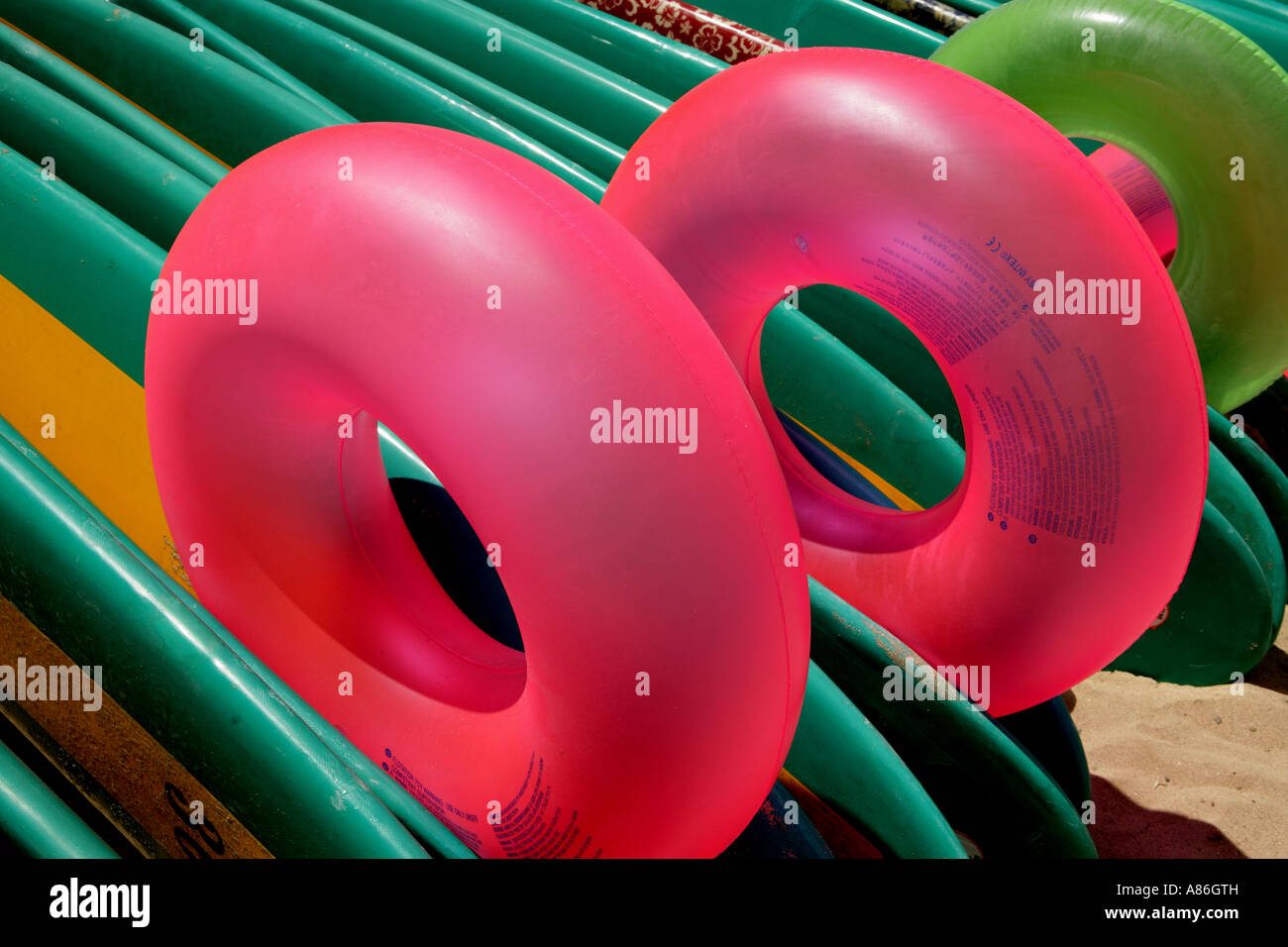 Floating rings and surfboards Stock Photo
