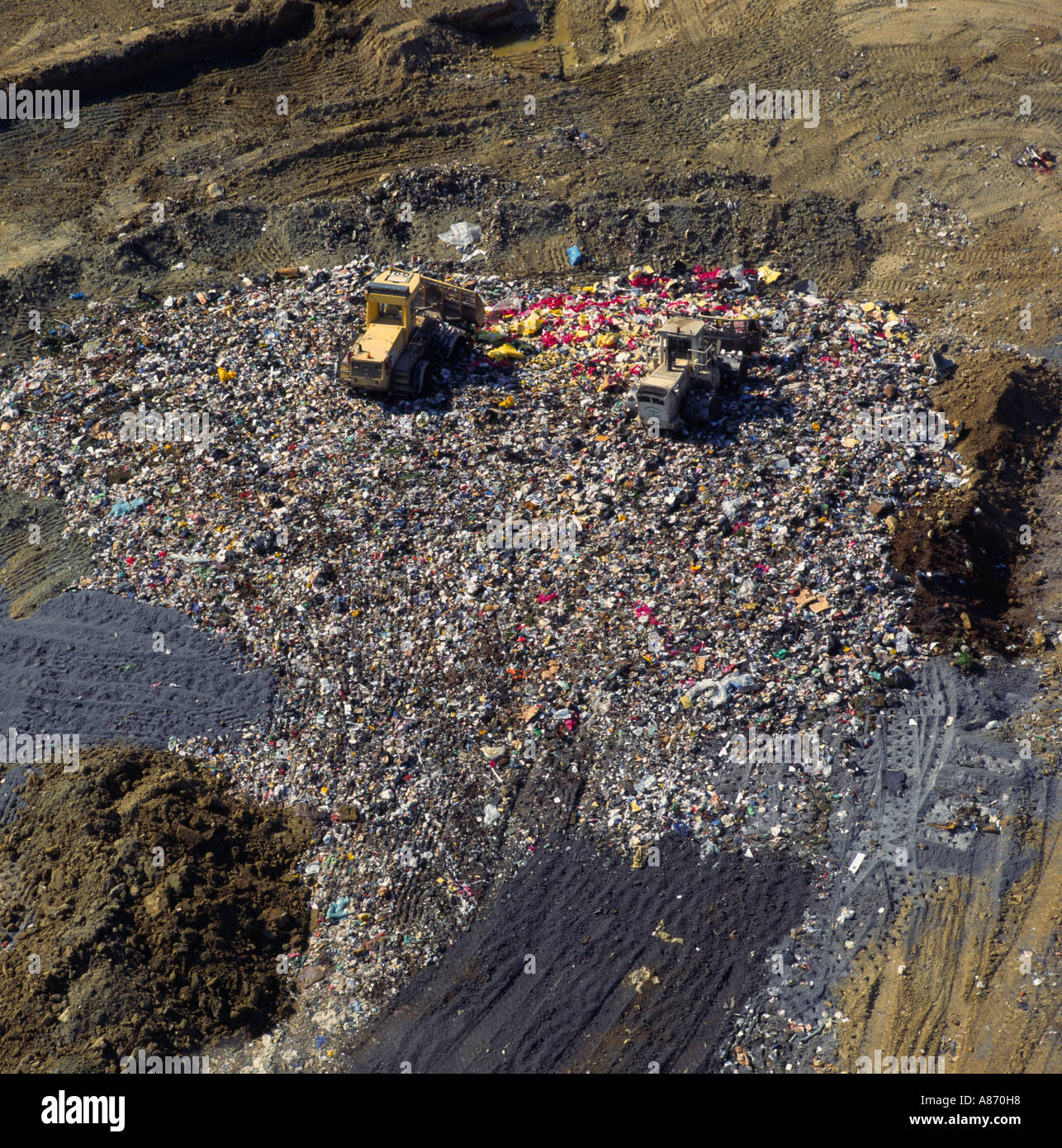 Diggers at work on landfill site UK aerial view - Stock Image