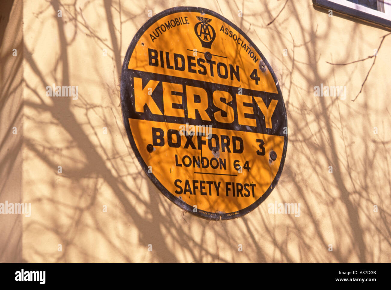 Old yellow road sign giving distances Kersey Suffolk England - Stock Image