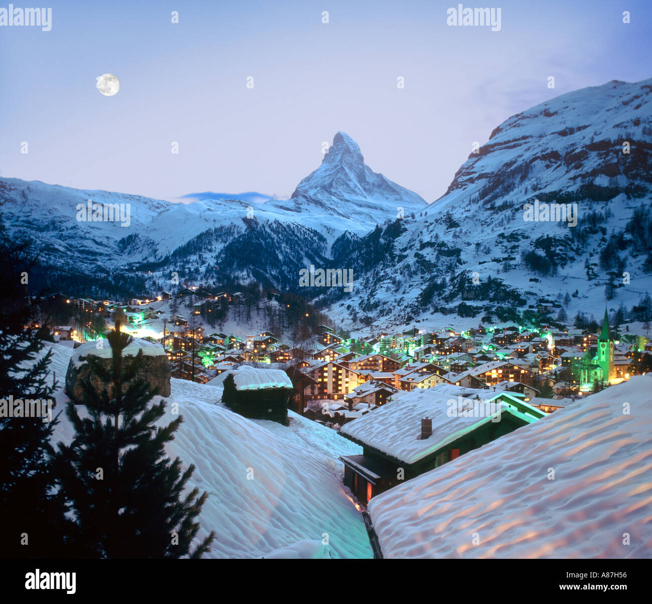 View over the resort towards the Matterhorn at dusk, Zermatt, Switzerland - Stock Image