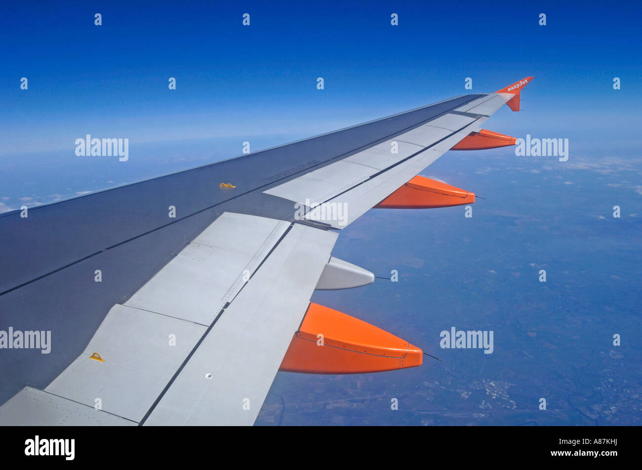 Wing of an Easyjet 737-700 at Cruising level of 33,000 feet - Stock Image