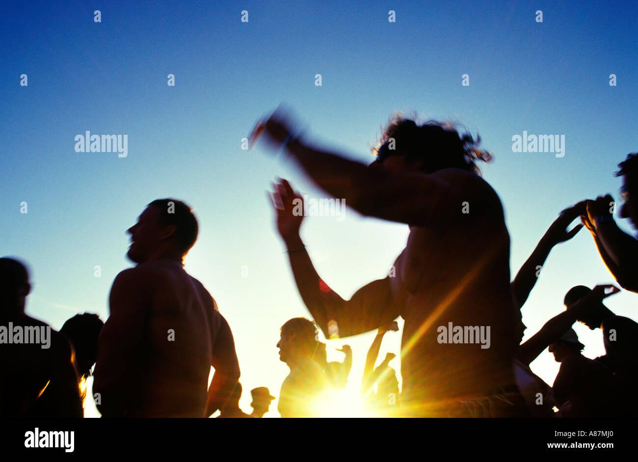 People dancing on Sa Trinchas beach Ibiza - Stock Image