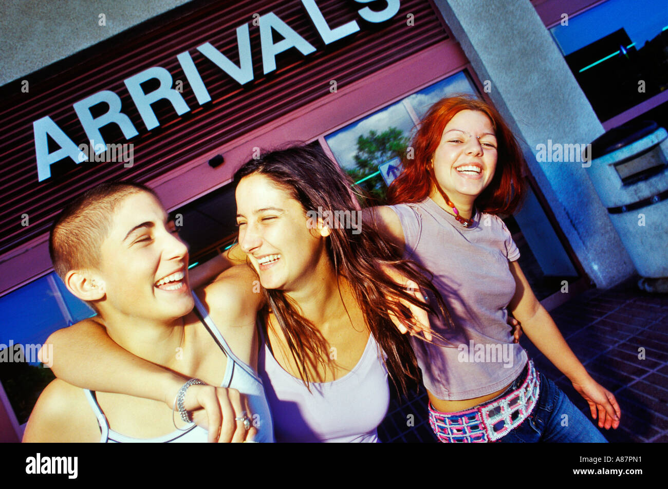 Girls arriving at the airport in Ibiza. - Stock Image