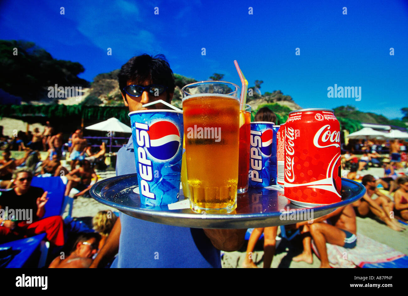 Ice cold drinks being served at Sa Trinchas beach Ibiza - Stock Image