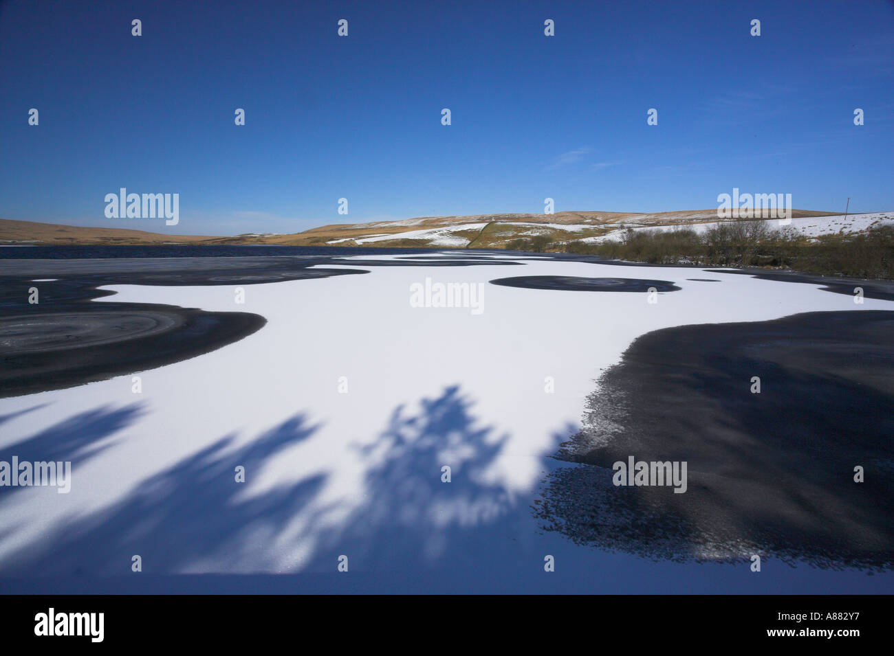 Belmont reservoir frozen in winter after snowfall Lancashire UK Stock Photo